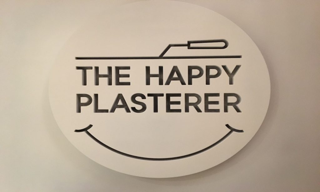 GoDaddy Happy plasterer logo